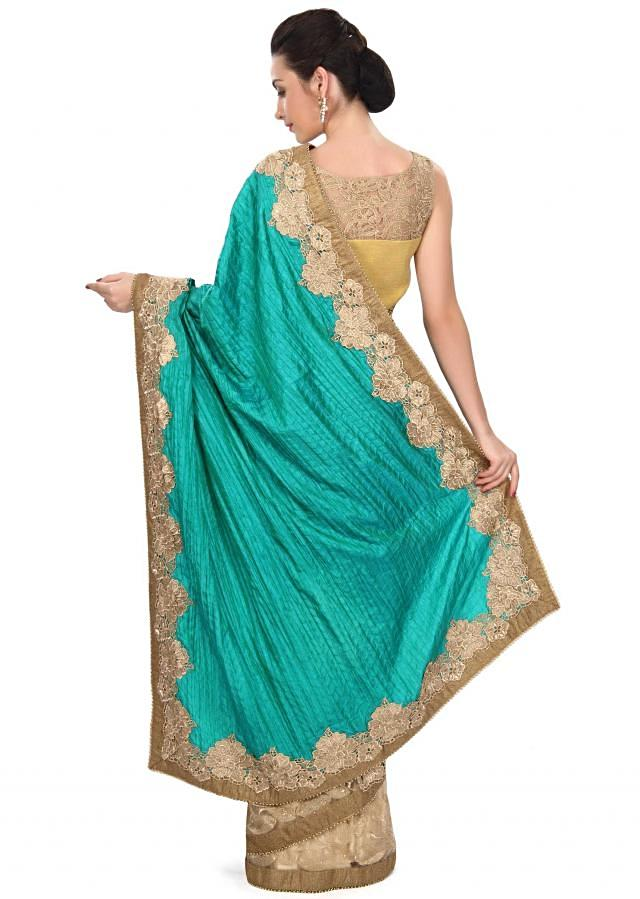 Half and half saree in dark green and beige with zari cut work border only on Kalki