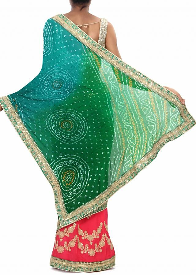 Half and half bandhani saree in green and pink with zari and sequin embroidery only on Kalki