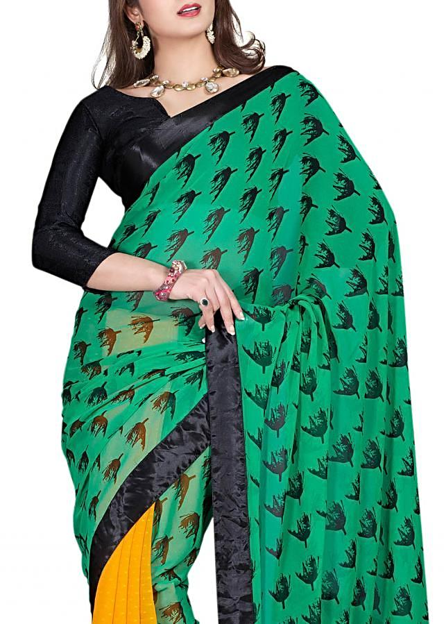 Half and half saree in green and yellow enhanced with floral motif