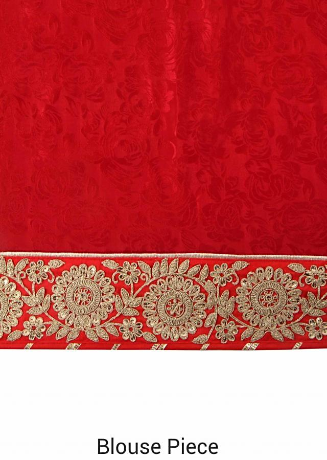 Half and half saree in maroon and cream in embroidered border only on Kalki