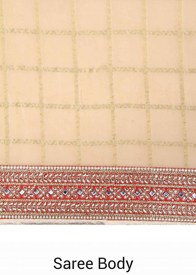 Half and half saree in maroon and beige in mirror border only on Kalki