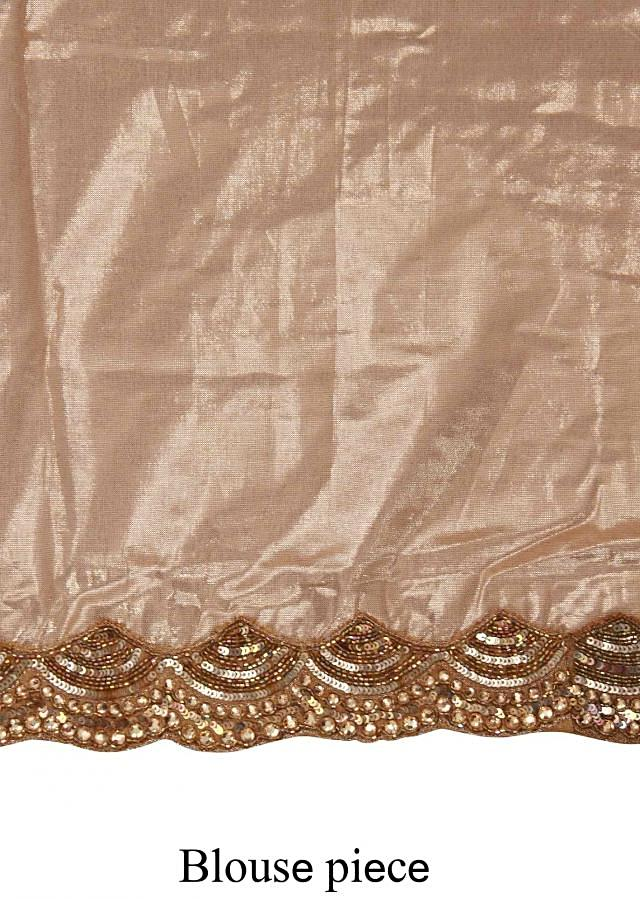 Half and half saree in orange and beige features with embroidered border only on Kalki