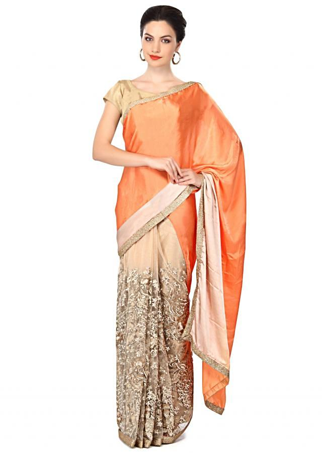 Half and half saree in peach and beige adorn in resham embroidery only on Kalki