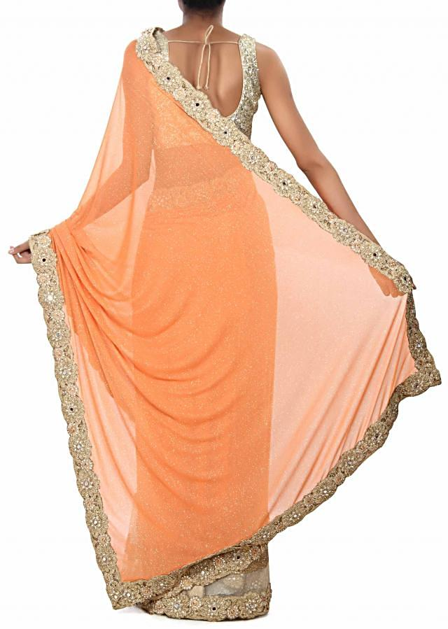 Half and half saree in peach and beige with sequin and cut work border. only on Kalki