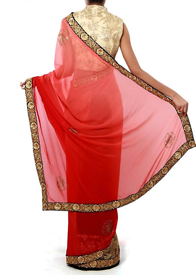 Half and half saree in pink and beige features with embroidered border only on Kalki