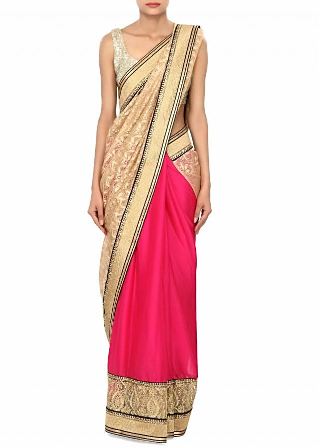 Half and half saree in pink and gold embellished in embroidered border only on Kalki