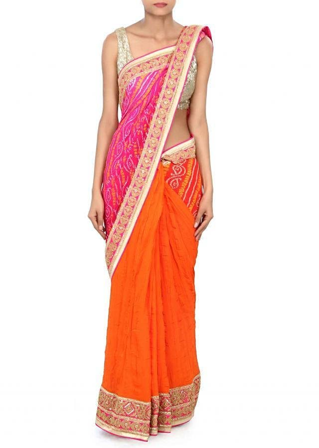 Half and half saree in pink and orange in embroidered border only on Kalki