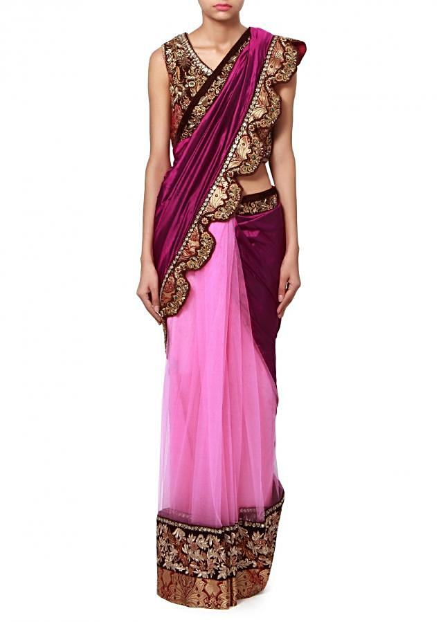 Half and half saree in purple and pink enhanced in embroidered border only on Kalki