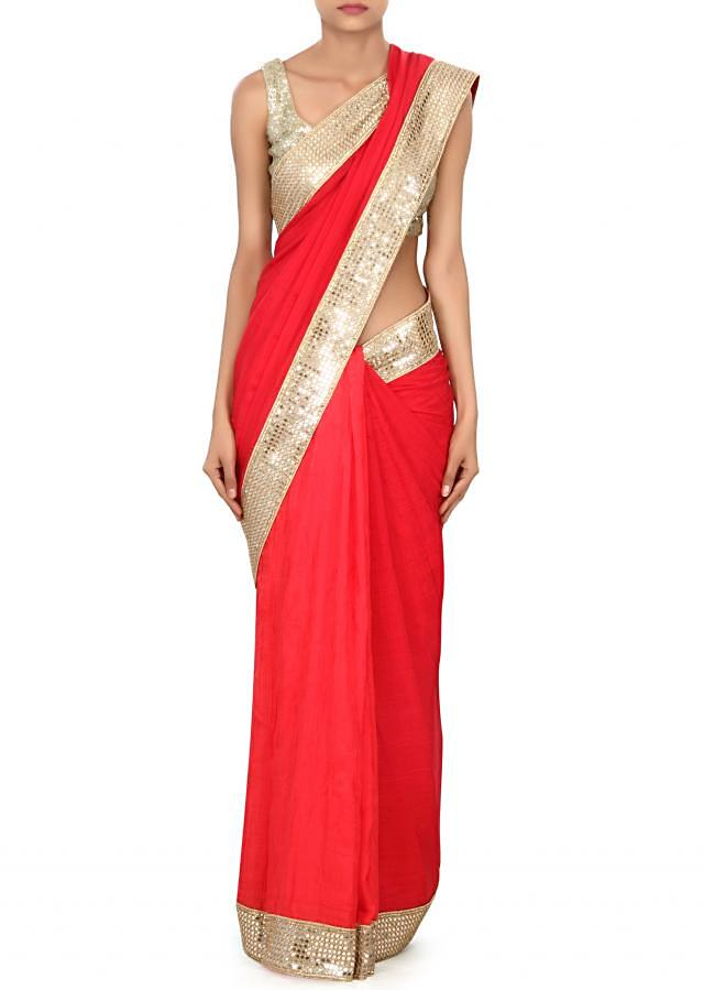 Half and half saree in red and gold adorn in mirror border only on Kalki