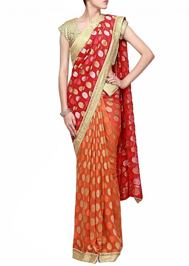 Half and half saree in red and orange embroidered in zari border only on Kalki