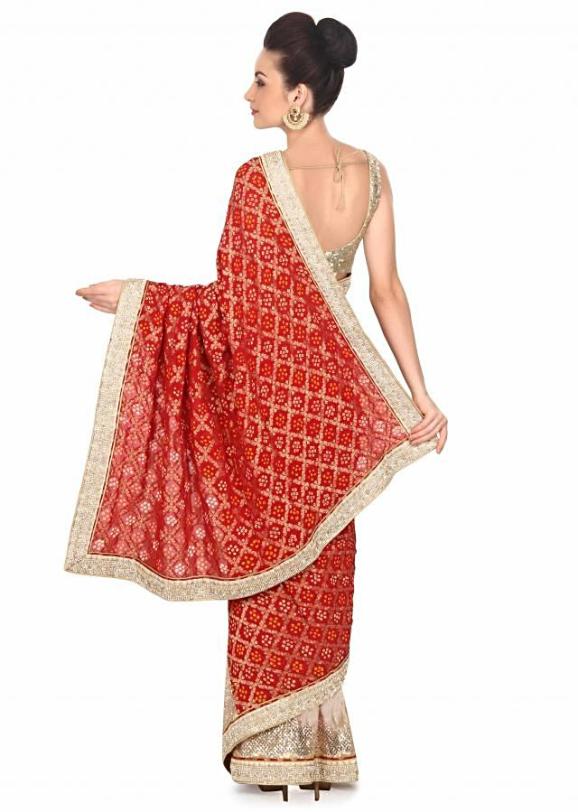 Half and half saree in red bandhani with embellished border only on Kalki