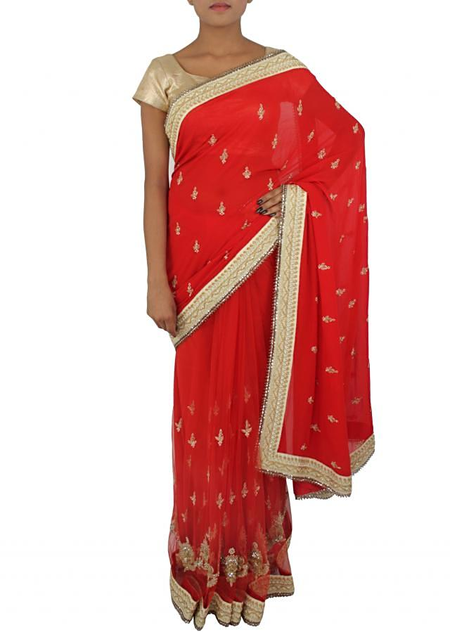 Half and half saree in red is embellished in pearl and kardana only on Kalki