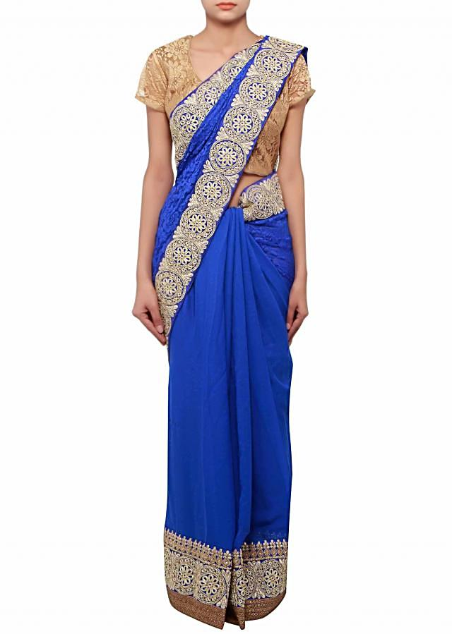 Half and half saree in royal blue adorn in zari lace only on Kalki