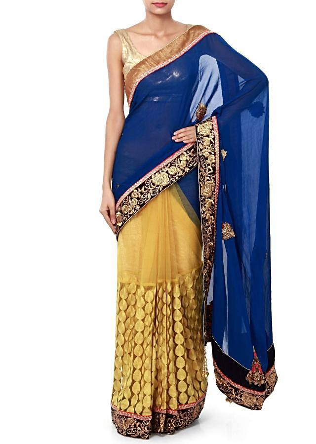 Half and half saree in royal blue and yellow adorn in embroidery only on Kalki