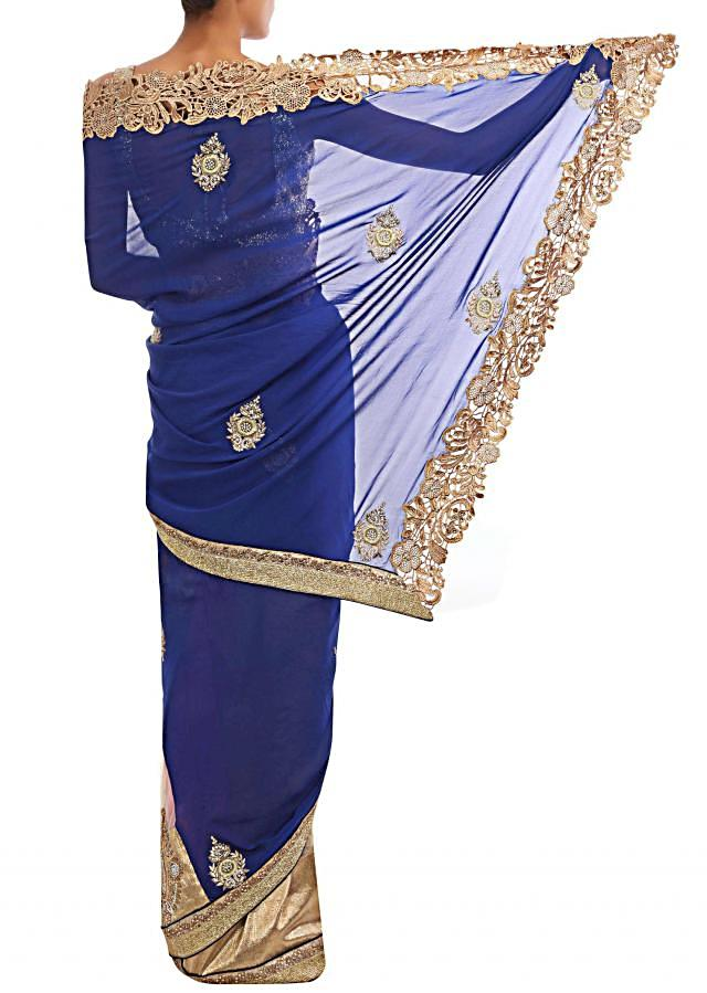 Ultramarine blue and cream georgette half saree enhanced in paisely motif in zardosi and pearl.