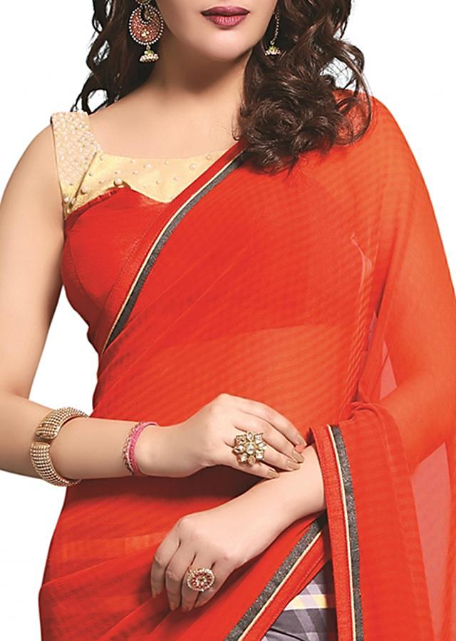 Half and half saree in orange with embroidered border