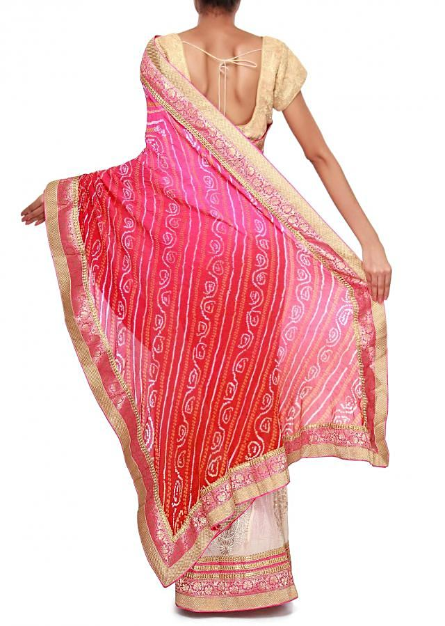 Half and half saree in red and cream adorn in brocade border only on Kalki