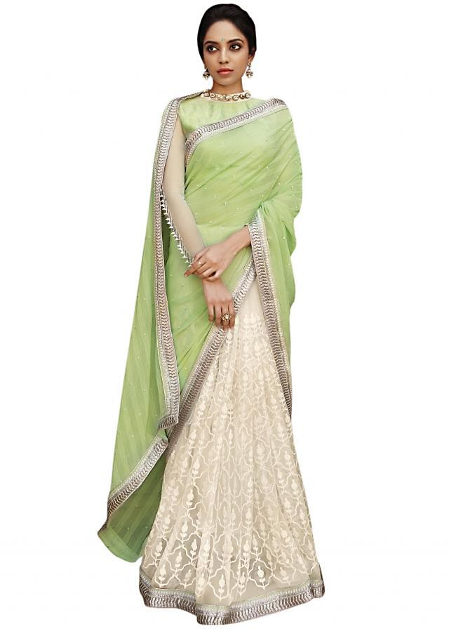 Half and half saree in white and green adorn in thread