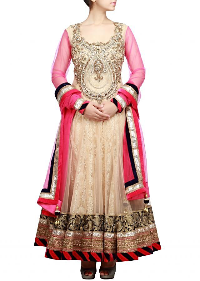 Heavy adorn anarkali suit in gold featuring with embellished bodice only on Kalki