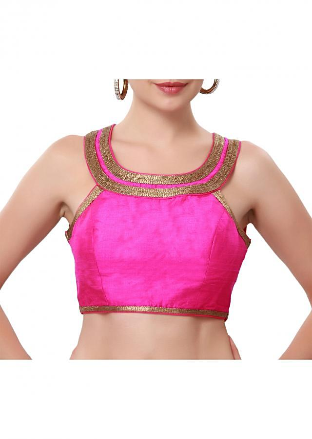 Hot pink blouse enhanced in gold zari lace only on Kalki