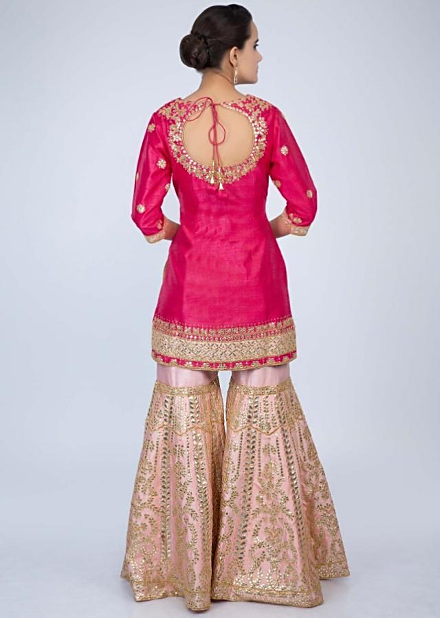 Hot pink gotta embroidered suit and dupatta with contrasting powder pink sharara only on Kalki
