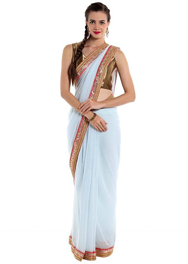 Ice blue georgette saree crafted with gotta patch work only on Kalki