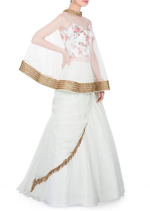 Ice Blue Georgette Skirt, Lycra Top and Net Cape Designed with Tassels only on Kalki