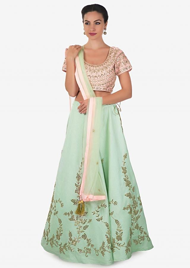 Ice blue lehenga with pink embroidered blouse adorn in gotta patch and moti work only on Kalki