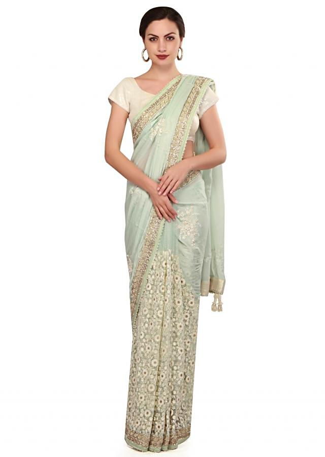 Ice blue saree adorn in thread ad pearl embroidery only on Kalki