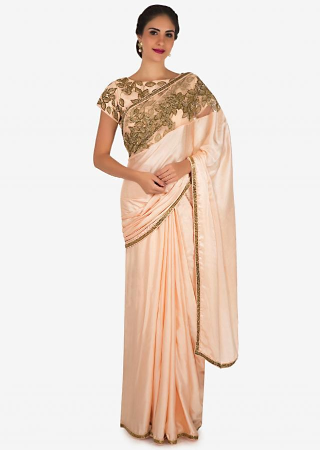 Ice peach saree in saree in satin silk embellished in cut dana embroidery work only on Kalki