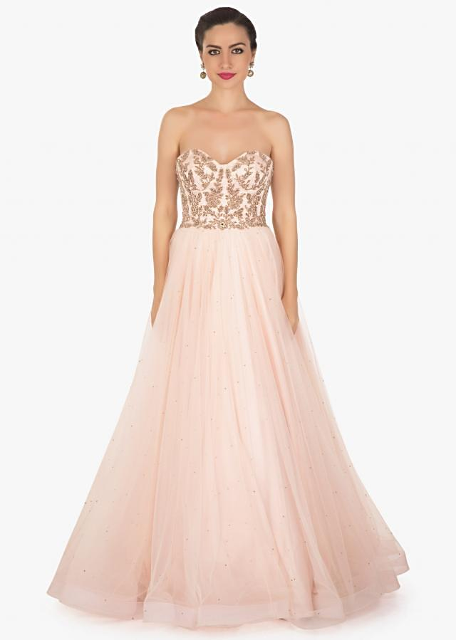 Ice pink corset gown in net with fancy cape highlighted in feathers only on Kalki