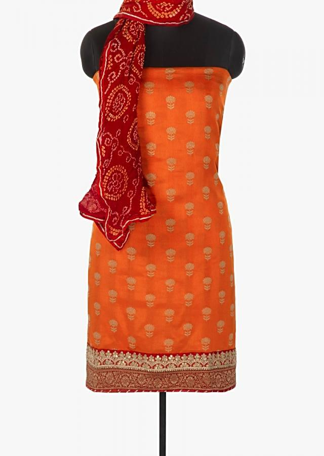 Orange weaved unstitched suit in silk with brocade border only on Kalki