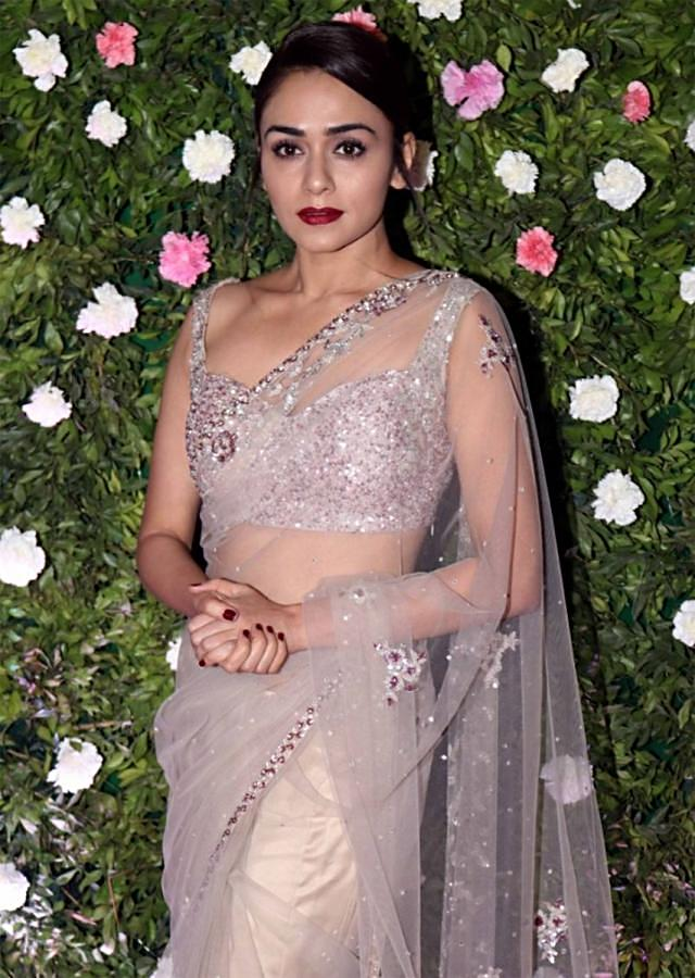 Amruta Khanvilkar in Kalki grey sheer net saree with floral embroidered butti