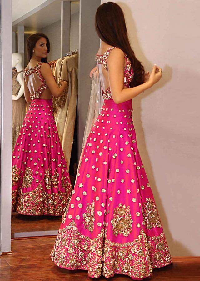 Rani pink gown embroidered in 3D flower embroidery only on Kalki