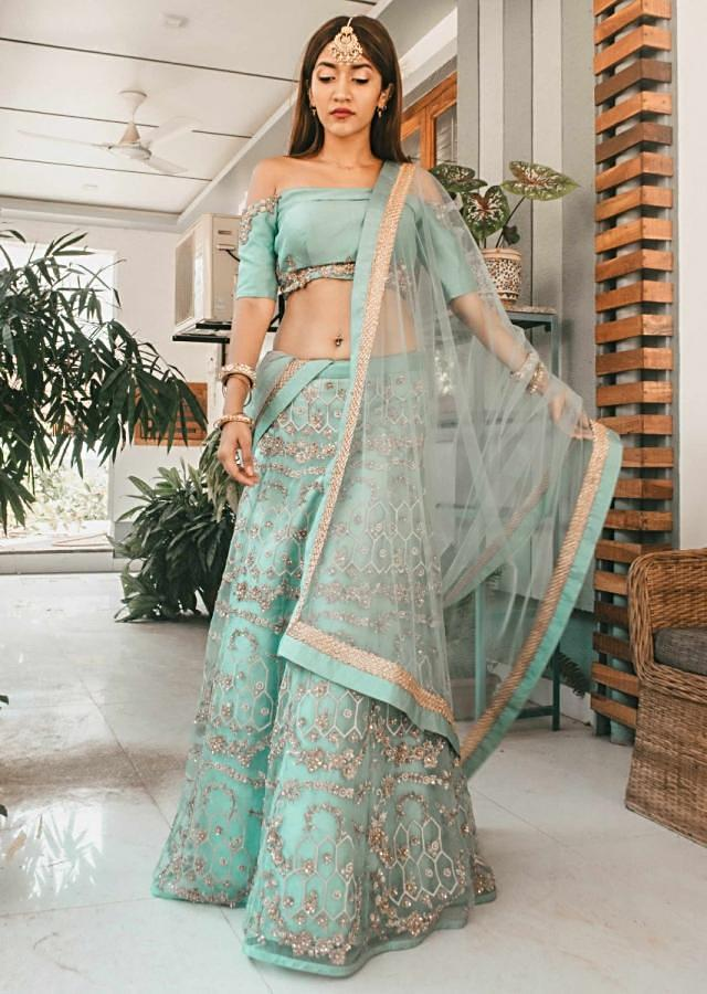 Sea green lehenga with off shoulder blouse in zari and sequin embroidery only on Kalki