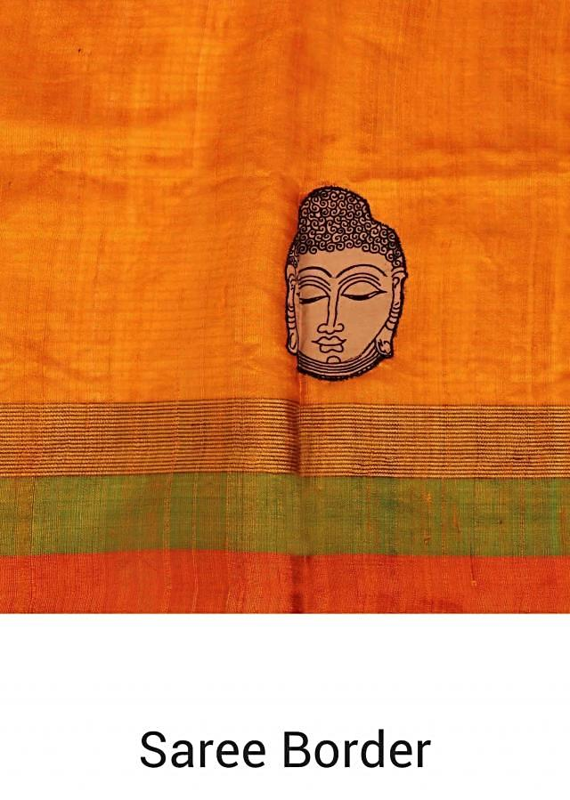 Mustard silk saree with Buddha face motif all over only on Kalki