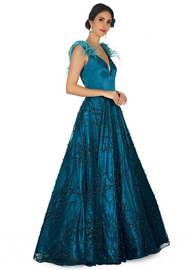 Bottle green indo western gown with embroidered side cuts at waist only on Kalki