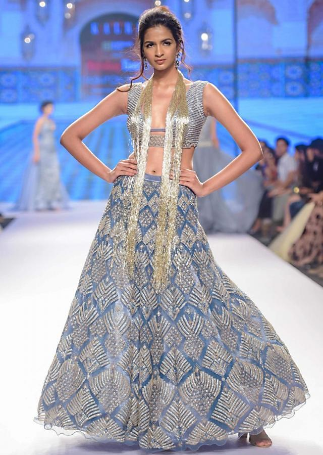 Natalie in kalki Iris blue net lehenga and blouse with attached net  drape with side slits