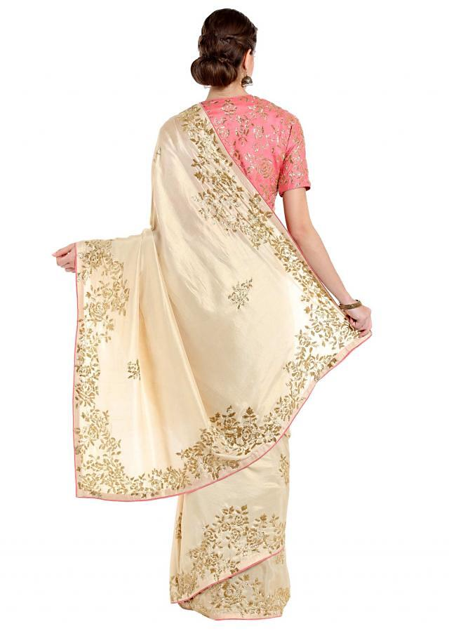 Ivory cream saree in cut dana embroidered butti and border only on Kalki