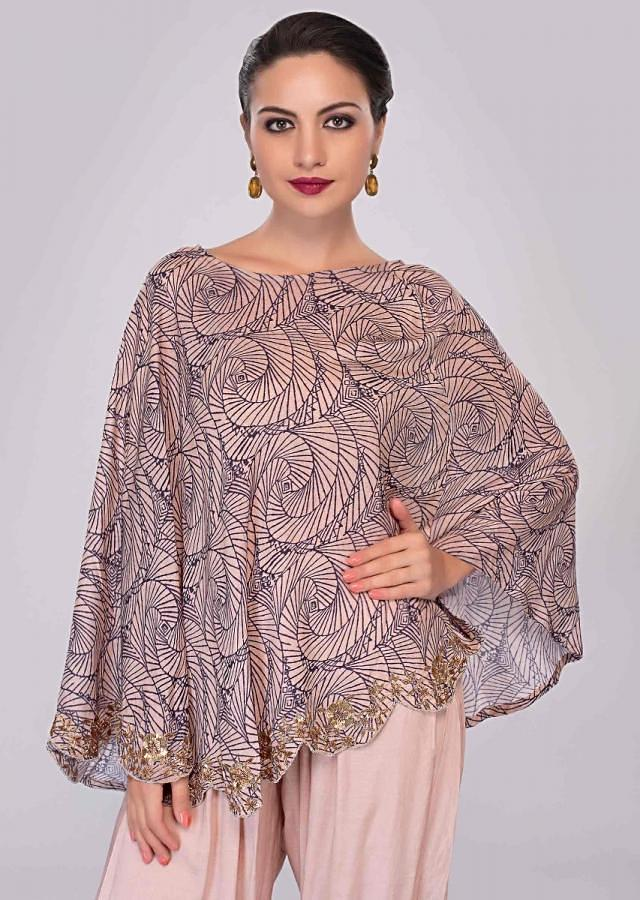 Ivory dhoti pant paired with cape top in print and scallop border only on Kalki