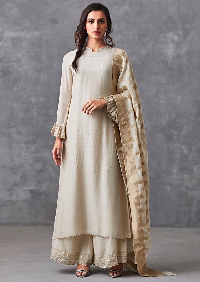 Ivory straight suit adorn in badla work matched with palazzo suit