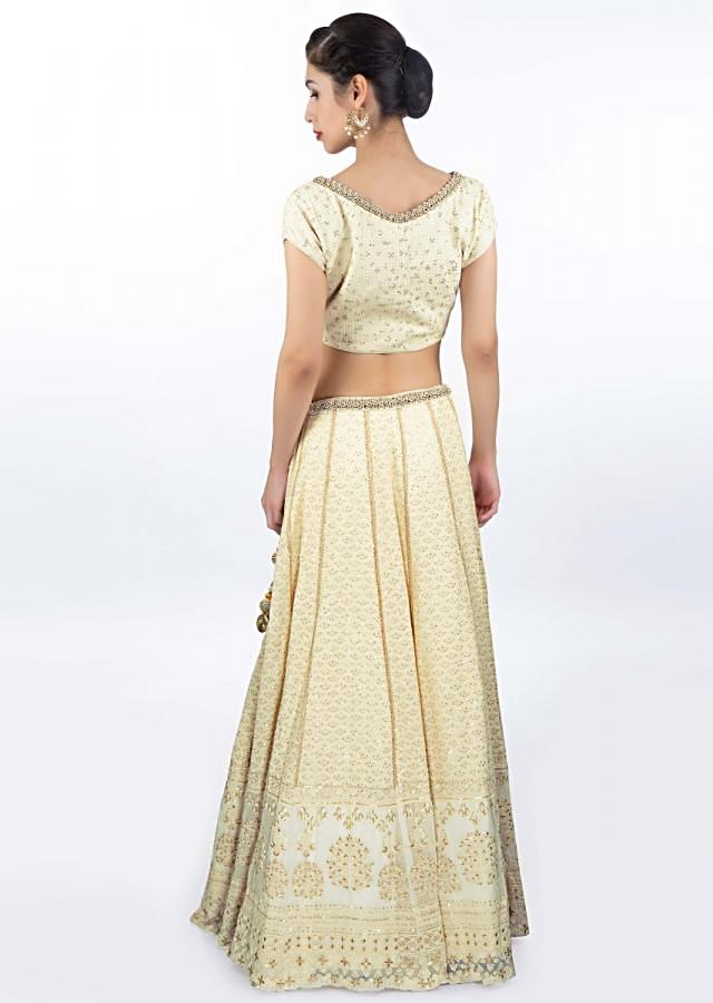Ivory thread embroidered lehenga paired with a matching round neck blouse and chiffon dupatta only on Kalki