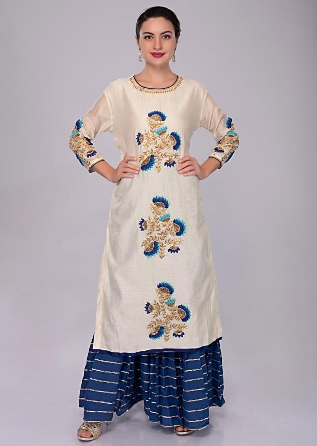 Ivory White Suit With Center Embroidered Butti Teamed With Cobalt Blue Sharara And Dupatta Online - Kalki Fashion