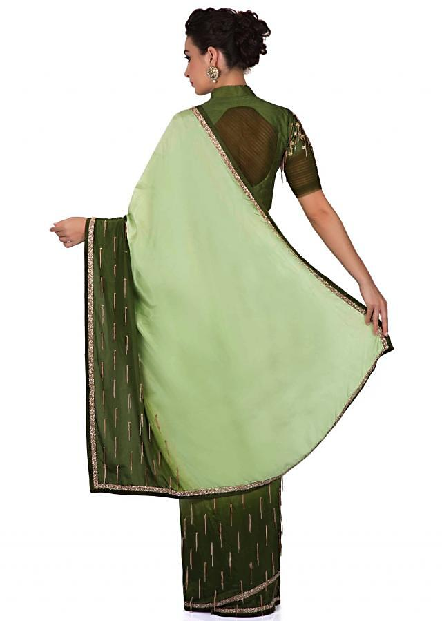 Jade green and cedar green saree with chain tassel only on Kalki