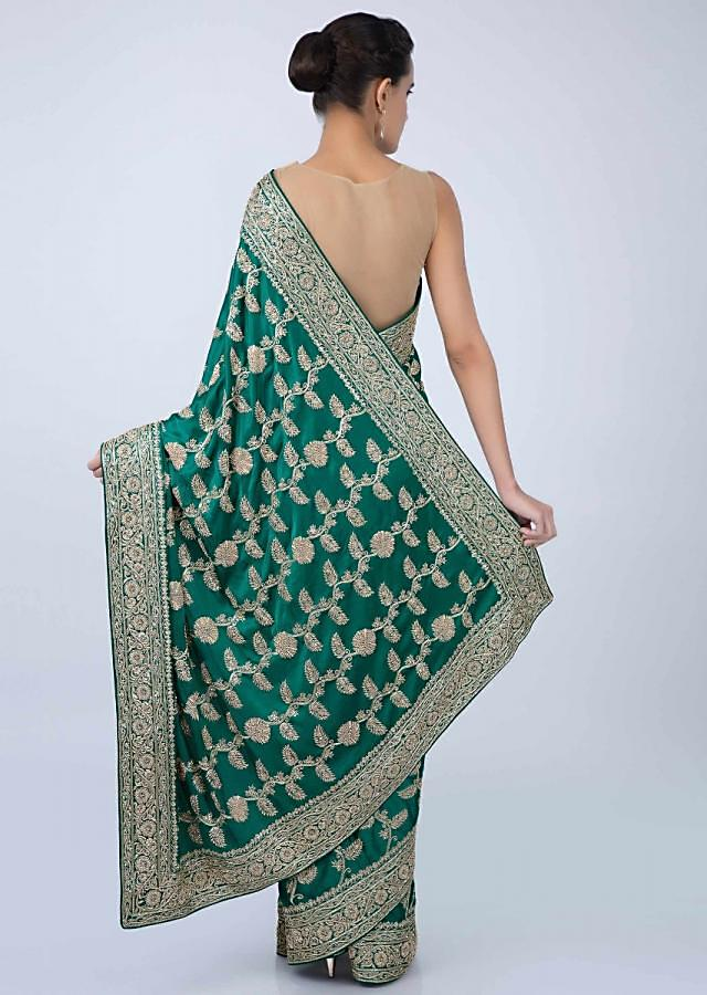 Jade green heavy  jaal embroidered satin saree only on kalki