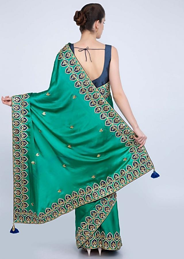 Jade green satin saree with embroidered patch work on the borders only on kalki