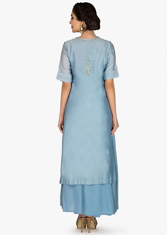 Jade blue suit in cotton with paisley motif embroidery only on Kalki