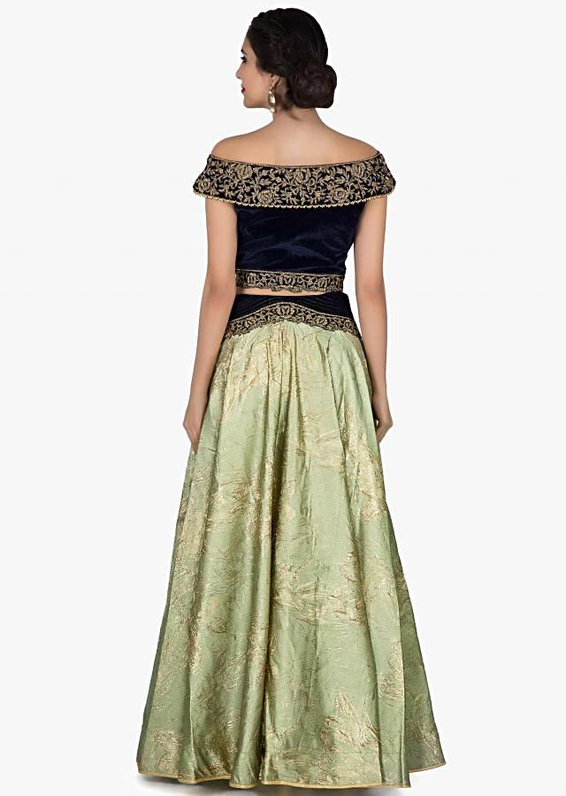 Jade green lehenga in silk with velvet zardosi embroidered blouse only on Kalki