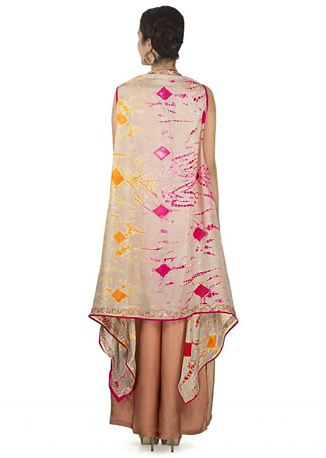 Jumpsuit in light brown and peach matched with printed long jacket only on Kalki