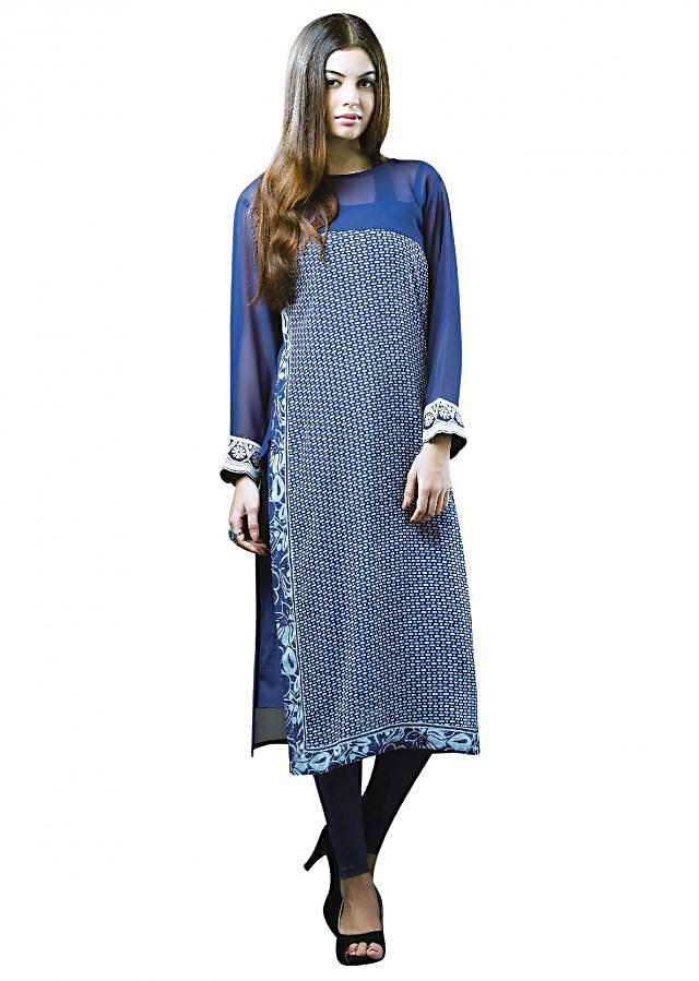 Kurti featuring in navy blue georgette. Its enhanced in geometric and floral print along with plain yoke.